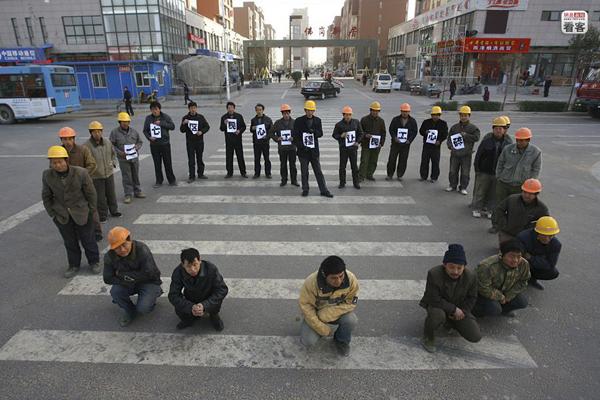 Lavoratori cinesi in sciopero