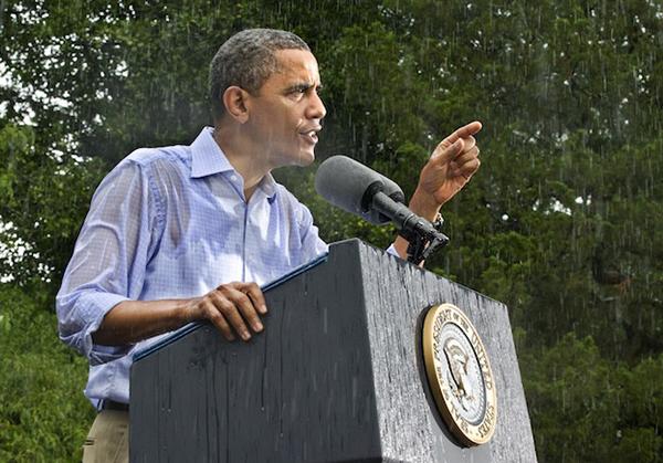 Un comizio di Obama sotto la pioggia